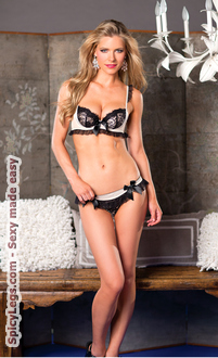 Two piece black and white ruffle lace and satin bra and brief set.